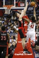 Feb 18, 2014; Washington, DC, USA; Washington Wizards power forward Nene (42) shoots the ball over Toronto Raptors power forward Tyler Hansbrough (50) in the fourth quarter at Verizon Center. The Raptors won 103-93. Mandatory Credit: Geoff Burke-USA TODAY Sports