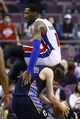 Feb 18, 2014; Auburn Hills, MI, USA; Charlotte Bobcats power forward Josh McRoberts (11) is fouled by Detroit Pistons center Andre Drummond (0) in the fourth quarter at The Palace of Auburn Hills. Charlotte won 108-96. Mandatory Credit: Rick Osentoski-USA TODAY Sports