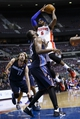 Feb 18, 2014; Auburn Hills, MI, USA; Detroit Pistons small forward Josh Smith (6) goes to the basket defended by Charlotte Bobcats feater Al Jefferson (25) in the fourth quarter at The Palace of Auburn Hills. Charlotte won 108-96. Mandatory Credit: Rick Osentoski-USA TODAY Sports