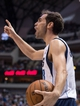 Feb 18, 2014; Dallas, TX, USA; Dallas Mavericks point guard Jose Calderon (8) argues a foul call during the second half against the Miami Heat at the American Airlines Center. The Heat defeated the Mavericks  117-106. Mandatory Credit: Jerome Miron-USA TODAY Sports