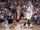 Feb 18, 2014; Dallas, TX, USA; Dallas Mavericks point guard Devin Harris (20) is knocked to the floor by Miami Heat small forward LeBron James (6) during the second half at the American Airlines Center. The Heat defeated the Mavericks  117-106. Mandatory Credit: Jerome Miron-USA TODAY Sports