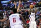 February 18, 2014; Los Angeles, CA, USA; Los Angeles Clippers shooting guard Jamal Crawford (11) shoots a three point basket against the San Antonio Spurs during the first half at Staples Center. Mandatory Credit: Gary A. Vasquez-USA TODAY Sports