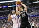 February 18, 2014; Los Angeles, CA, USA; San Antonio Spurs power forward Aron Baynes (16) grabs a rebound against Los Angeles Clippers small forward Jared Dudley (9) during the first half at Staples Center. Mandatory Credit: Gary A. Vasquez-USA TODAY Sports