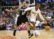 February 18, 2014; Los Angeles, CA, USA; Los Angeles Clippers point guard Chris Paul (3) moves the ball against  San Antonio Spurs  point guard Shannon Brown (1) during the first half at Staples Center. Mandatory Credit: Gary A. Vasquez-USA TODAY Sports