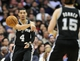 February 18, 2014; Los Angeles, CA, USA; San Antonio Spurs shooting guard Danny Green (4) passes the ball to power forward Matt Bonner (15) against the Los Angeles Clippers during the first half at Staples Center. Mandatory Credit: Gary A. Vasquez-USA TODAY Sports