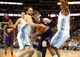 Feb 18, 2014; Denver, CO, USA; Phoenix Suns guard Goran Dragic (center) drives to the basket against Denver Nuggets guard Evan Fournier (left) during the second half at Pepsi Center.  The Suns won 112-107 in overtime.  Mandatory Credit: Chris Humphreys-USA TODAY Sports