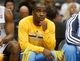 Feb 18, 2014; Denver, CO, USA; Denver Nuggets guard Ty Lawson watches from the bench during the first half against the Phoenix Suns at Pepsi Center. Mandatory Credit: Chris Humphreys-USA TODAY Sports