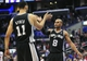 February 18, 2014; Los Angeles, CA, USA; San Antonio Spurs point guard Patty Mills (8) and center Jeff Ayres (11) celebrate the 113-103 victory against the Los Angeles Clippers at Staples Center. Mandatory Credit: Gary A. Vasquez-USA TODAY Sports