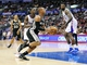 February 18, 2014; Los Angeles, CA, USA; San Antonio Spurs point guard Patty Mills (8) moves to the basket against Los Angeles Clippers point guard Darren Collison (2) and center DeAndre Jordan (6) during the second half at Staples Center. Mandatory Credit: Gary A. Vasquez-USA TODAY Sports