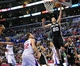February 18, 2014; Los Angeles, CA, USA; San Antonio Spurs shooting guard Manu Ginobili (20) scores a basket against the Los Angeles Clippers during the second half at Staples Center. Mandatory Credit: Gary A. Vasquez-USA TODAY Sports