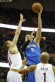 Feb 19, 2014; Cleveland, OH, USA; Orlando Magic center Nikola Vucevic (9) shoots between Cleveland Cavaliers center Tyler Zeller (40) and point guard Jarrett Jack (1) in the second quarter at Quicken Loans Arena. Mandatory Credit: David Richard-USA TODAY Sports