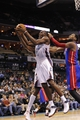 Feb 19, 2014; Charlotte, NC, USA; Charlotte Bobcats forward center Bismack Biyombo (0) and Detroit Pistons center Andre Drummond (0) fight for a rebound during the first half of the game at Time Warner Cable Arena. Mandatory Credit: Sam Sharpe-USA TODAY Sports