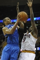 Feb 19, 2014; Cleveland, OH, USA; Orlando Magic shooting guard Arron Afflalo (left) shoots against Cleveland Cavaliers small forward Luol Deng (9) in the fourth quarter at Quicken Loans Arena. Mandatory Credit: David Richard-USA TODAY Sports