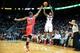 Feb 19, 2014; Atlanta, GA, USA; Atlanta Hawks shooting guard Louis Williams (3) shoots a three over Washington Wizards center Kevin Seraphin (13) in the second half at Philips Arena. The Wizards won 114-97. Mandatory Credit: Daniel Shirey-USA TODAY Sports