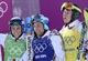 Feb 20, 2014; Krasnaya Polyana, RUSSIA; French competitors Jean Frederic Chapuis (green) and Arnaud Bovolenta (blue) and Jonathan Midol (yellow) react after the big final for men's ski cross during the Sochi 2014 Olympic Winter Games at Rosa Khutor Extreme Park. Mandatory Credit: Jack Gruber-USA TODAY Sports
