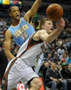 Feb 20, 2014; Milwaukee, WI, USA;  Milwaukee Bucks guard Nate Wolters (6) loses control of the ball against Denver Nuggets forward Anthony Randolph (15) in the 3rd quarter at BMO Harris Bradley Center. The Nuggets beat the Bucks 101-90. Mandatory Credit: Benny Sieu-USA TODAY Sports
