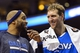 Feb 21, 2014; Philadelphia, PA, USA; Dallas Mavericks forward Dirk Nowitzki (41) talks with guard Vince Carter (25) during the fourth quarter against the Philadelphia 76ers at the Wells Fargo Center. The Mavericks defeated the Sixers 124-112. Mandatory Credit: Howard Smith-USA TODAY Sports