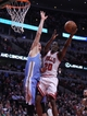 Feb 21, 2014; Chicago, IL, USA; Chicago Bulls shooting guard Tony Snell (20) shoots over Denver Nuggets center Timofey Mozgov (25) during the second half at the United Center. Chicago won 117-89. Mandatory Credit: Dennis Wierzbicki-USA TODAY Sports