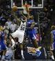 Feb 21, 2014; Memphis, TN, USA; Memphis Grizzlies power forward Zach Randolph (50) shoots the ball as Los Angeles Clippers center DeAndre Jordan (6) defends at FedExForum. The Grizzlies won 102 - 96. Mandatory Credit: Justin Ford-USA TODAY Sports