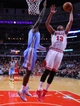 Feb 21, 2014; Chicago, IL, USA; Chicago Bulls center Joakim Noah (13) shoots over Denver Nuggets center J.J. Hickson (7) during the second half at the United Center. Chicago won 117-89. Mandatory Credit: Dennis Wierzbicki-USA TODAY Sports