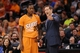 Feb 21, 2014; Phoenix, AZ, USA; Phoenix Suns head coach Jeff Hornacek talks with guard Archie Goodwin (20) on the sidelines against the San Antonio Spurs in the second half at US Airways Center. The Suns defeated the Spurs 106-85. Mandatory Credit: Jennifer Stewart-USA TODAY Sports