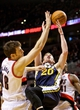 Feb 21, 2014; Portland, OR, USA; Utah Jazz shooting guard Gordon Hayward (20) is fouled by Portland Trail Blazers power forward Victor Claver (18) during the third quarter at the Moda Center. Mandatory Credit: Craig Mitchelldyer-USA TODAY Sports