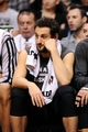 Feb 21, 2014; Phoenix, AZ, USA; San Antonio Spurs guard Marco Belinelli (3) reacts on the bench in the second half against the Phoenix Suns at US Airways Center. The Suns defeated the Spurs 106-85. Mandatory Credit: Jennifer Stewart-USA TODAY Sports