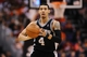 Feb 21, 2014; Phoenix, AZ, USA; San Antonio Spurs guard Danny Green (4) makes a pass against the Phoenix Suns in the second half at US Airways Center. The Suns defeated the Spurs 106-85. Mandatory Credit: Jennifer Stewart-USA TODAY Sports