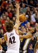 Feb 21, 2014; Portland, OR, USA; Utah Jazz point guard Alec Burks (10) shoots over Portland Trail Blazers center Robin Lopez (42) during the fourth quarter at the Moda Center. Mandatory Credit: Craig Mitchelldyer-USA TODAY Sports