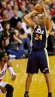 Feb 21, 2014; Portland, OR, USA; Utah Jazz small forward Richard Jefferson (24) shoots over Portland Trail Blazers shooting guard Wesley Matthews (2) during the fourth quarter at the Moda Center. Mandatory Credit: Craig Mitchelldyer-USA TODAY Sports