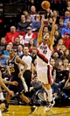 Feb 21, 2014; Portland, OR, USA; Portland Trail Blazers center Robin Lopez (42) grabs a rebound over Utah Jazz point guard Alec Burks (10) during the fourth quarter at the Moda Center. Mandatory Credit: Craig Mitchelldyer-USA TODAY Sports