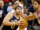 Feb 21, 2014; Portland, OR, USA; Utah Jazz center Enes Kanter (0) drives past Portland Trail Blazers center Robin Lopez (42) during the fourth quarter at the Moda Center. Mandatory Credit: Craig Mitchelldyer-USA TODAY Sports