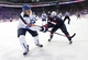 Feb 22, 2014; Sochi, RUSSIA; Finland defenseman Sami Salo (6) passes the puck away from USA forward Zach Parise (9) in the men's ice hockey bronze medal game during the Sochi 2014 Olympic Winter Games at Bolshoy Ice Dome. Mandatory Credit: Winslow Townson-USA TODAY Sports