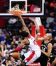 Feb 22, 2014; Washington, DC, USA; Washington Wizards forward Nene (42) dunks the ball over New Orleans Pelicans center Greg Stiemsma (34) in the first quarter at Verizon Center. Mandatory Credit: Evan Habeeb-USA TODAY Sports
