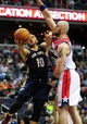 Feb 22, 2014; Washington, DC, USA; New Orleans Pelicans guard Eric Gordon (10) shoots the ball over Washington Wizards center Marcin Gortat (4) in the second quarter at Verizon Center. Mandatory Credit: Evan Habeeb-USA TODAY Sports