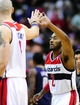 Feb 22, 2014; Washington, DC, USA; Washington Wizards guard John Wall (2) high fives center Marcin Gortat (4) in the fourth quarter against the New Orleans Pelicans at Verizon Center. Mandatory Credit: Evan Habeeb-USA TODAY Sports