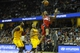Feb 23, 2014; Cleveland, OH, USA; Washington Wizards shooting guard Bradley Beal (3) shoots the ball in front of Cleveland Cavaliers point guard Kyrie Irving (2) and point guard Jarrett Jack (1) in the first quarter at Quicken Loans Arena. Mandatory Credit: David Richard-USA TODAY Sports