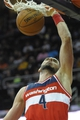 Feb 23, 2014; Cleveland, OH, USA; Washington Wizards center Marcin Gortat (4) dunks the ball against the Cleveland Cavaliers in the first quarter at Quicken Loans Arena. Mandatory Credit: David Richard-USA TODAY Sports