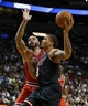 Feb 23, 2014; Miami, FL, USA;  Miami Heat small forward Michael Beasley (8) drives to the basket as Chicago Bulls power forward Carlos Boozer (5) defends in the second half at American Airlines Arena.The Heat won 93-79.  Mandatory Credit: Robert Mayer-USA TODAY Sports