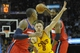 Feb 23, 2014; Cleveland, OH, USA; Cleveland Cavaliers shooting guard Matthew Dellavedova (8) defends between Washington Wizards shooting guard Bradley Beal (3) and power forward Nene Hilario (42) in the second quarter at Quicken Loans Arena. Mandatory Credit: David Richard-USA TODAY Sports