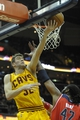 Feb 23, 2014; Cleveland, OH, USA; Cleveland Cavaliers center Spencer Hawes (32) shoots against Washington Wizards power forward Nene Hilario (42) in the third quarter at Quicken Loans Arena. Mandatory Credit: David Richard-USA TODAY Sports