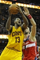 Feb 23, 2014; Cleveland, OH, USA; Cleveland Cavaliers power forward Tristan Thompson (13) drives against Washington Wizards center Marcin Gortat (4) in the third quarter at Quicken Loans Arena. Mandatory Credit: David Richard-USA TODAY Sports