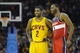 Feb 23, 2014; Cleveland, OH, USA; Cleveland Cavaliers point guard Kyrie Irving (2) and Washington Wizards point guard John Wall (2) talk in the fourth quarter at Quicken Loans Arena. Mandatory Credit: David Richard-USA TODAY Sports