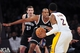 February 23, 2014; Los Angeles, CA, USA; Brooklyn Nets center Jason Collins (46) defends against Los Angeles Lakers shooting guard MarShon Brooks (2) during the first half at Staples Center. Mandatory Credit: Gary A. Vasquez-USA TODAY Sports