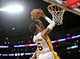 February 23, 2014; Los Angeles, CA, USA; Los Angeles Lakers shooting guard Kent Bazemore (6) scores a basket against the Brooklyn Nets during the second half at Staples Center. Mandatory Credit: Gary A. Vasquez-USA TODAY Sports