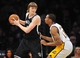 February 23, 2014; Los Angeles, CA, USA; Brooklyn Nets small forward Andrei Kirilenko (47) controls the ball against Los Angeles Lakers small forward Wesley Johnson (11) during the second half at Staples Center. Mandatory Credit: Gary A. Vasquez-USA TODAY Sports
