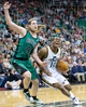 Feb 24, 2014; Salt Lake City, UT, USA; Utah Jazz point guard Alec Burks (10) dribbles the ball around Boston Celtics center Kelly Olynyk (41) during the second half at EnergySolutions Arena. The Jazz won 110-98. Mandatory Credit: Russ Isabella-USA TODAY Sports