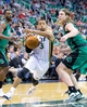 Feb 24, 2014; Salt Lake City, UT, USA; Utah Jazz point guard Trey Burke (3) dribbles the ball around Boston Celtics center Kelly Olynyk (41) during the second half at EnergySolutions Arena. The Jazz won 110-98. Mandatory Credit: Russ Isabella-USA TODAY Sports