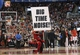 Feb 19, 2014; Toronto, Ontario, CAN; The Toronto Raptors mascot Stripes holds a sign against the Chicago Bulls at Air Canada Centre. The Bulls beat the Raptors 94-92. Mandatory Credit: Tom Szczerbowski-USA TODAY Sports