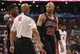 Feb 19, 2014; Toronto, Ontario, CAN; Chicago Bulls forward Taj Gibson (22) questions a foul called against him by official Olandis Poole (50) against the Toronto Raptors at Air Canada Centre. The Bulls beat the Raptors 94-92. Mandatory Credit: Tom Szczerbowski-USA TODAY Sports